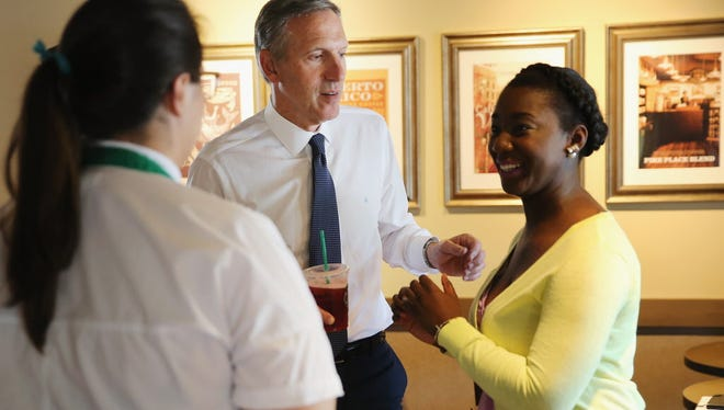 Starbucks CEO Howard Schultz greets and thanks employees and others at the coffee shop around the corner from the historic Emanuel African Methodist Episcopal Church on June 19, 2015 in Charleston, South Carolina. Starbucks on Monday announced it will open 15 stores that will double as job training centers in urban areas throughout the U.S.