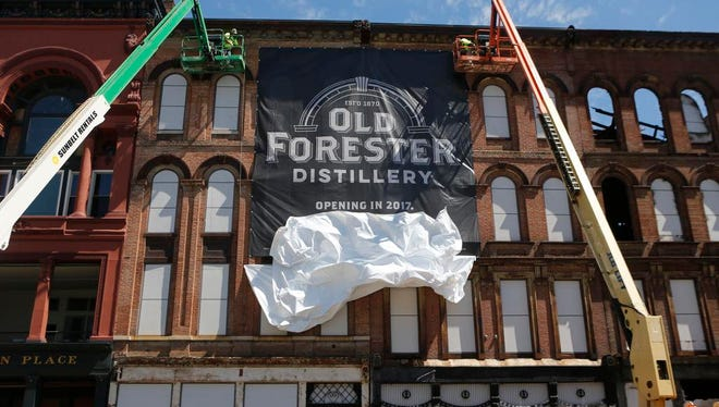 A banner was unveiled at the site of the Old Forrester on Main street after groundbreaking for the new distillery. July 22, 2015.