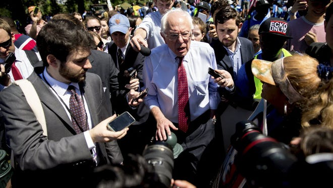Sen. Bernie Sanders, I-Vt., speaks to reporters after a Capitol Hill rally on July 22, 2015, to push for increasing the minimum wage to $15 an hour.