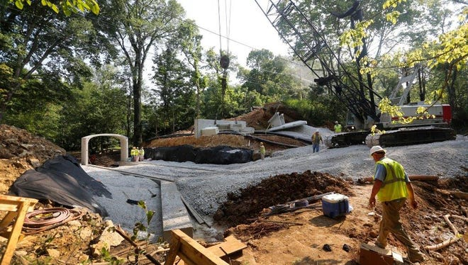 Workers installed the first piece of the precast, concrete culvert on Brownsboro Road in July 2015.