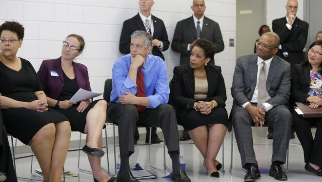 Education Secretary Arne Duncan, third from left, and Attorney General Loretta Lynch visit inmates in Jessup, Md., on July 31, 2015.