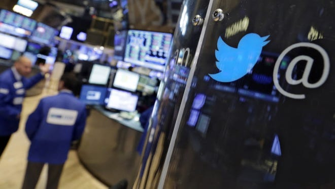 The logo for Twitter adorns a phone post on the floor of the New York Stock Exchange