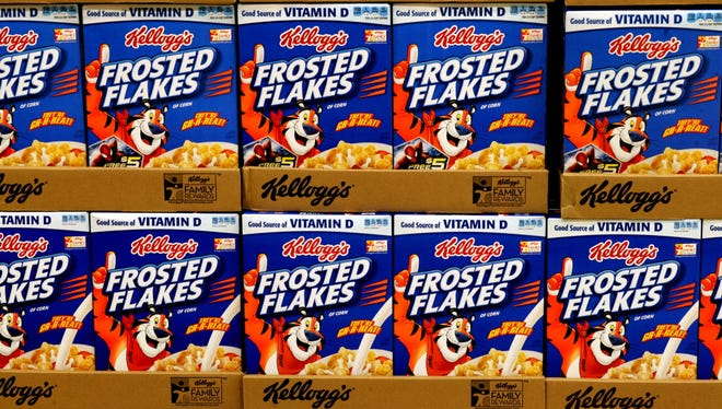 In this April 9, 2014 photo, Kellogg's Frosted Flakes are stocked on shelves at a grocery store in Fargo, N.D. Kellogg said, Tuesday, Aug. 4, 2015, that its U.S. cereal division saw another decline in quarterly sales but that trends in the category were improving. (AP Photo/Bruce Crummy) ORG XMIT: NY114
