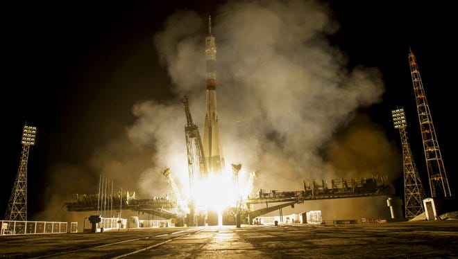 The Soyuz-FG booster rocket with the space capsule Soyuz TMA-14M is launched to the International Space Station on July 23, 2015.