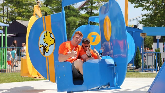 Cincinnati Bengals Pro Bowl quarterback Andy Dalton enjoys a ride with his wife, Jordan, on the Woodstock Gliders at Kings Island on Sunday.