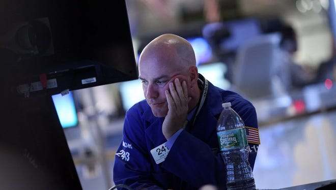 Traders work on the floor of the New York Stock Exchange on Aug. 25, 2015, in New York.
