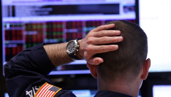 Traders work on the floor of the New York Stock Exchange (NYSE) on September 4, 2015 in New York City.