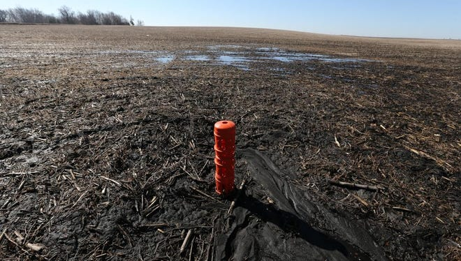 Tile system used to drain water that ends up in the Raccoon River shown Monday March 9, 2015, at Dwight Dial's Calhoun County farm near Lake City, Iowa.