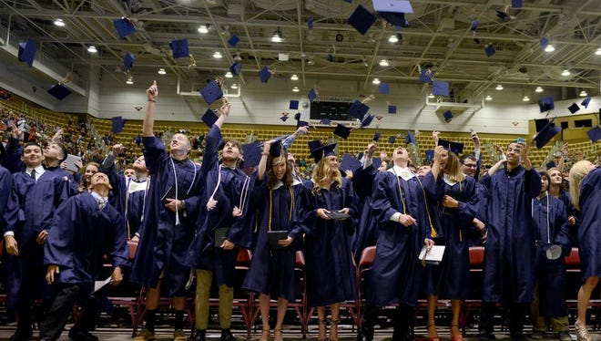 Over 320 graduates from Roberson High School were recognized during commencement ceremony honoring the schoolÕs 2015 class of seniors at the U.S. Cellular Center in downtown Saturday.