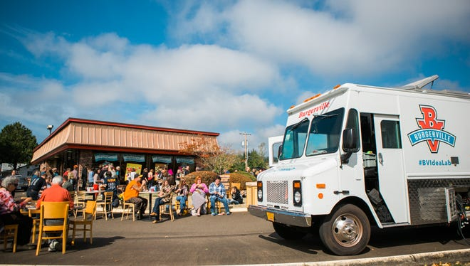Burgerville's Nomad, its mobile food truck, is parked in front of what will be the chain's southern-most restaurant in Corvallis. More than 700 local residents enjoyed a lunch of Original Cheeseburgers, fresh baked cookies and lemonade and conversation.