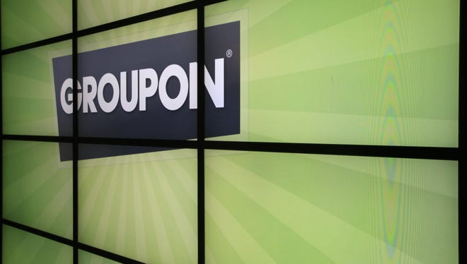 This Oct. 21, 2011, photo shows the Groupon logo inside the online coupon company's offices in Chicago.