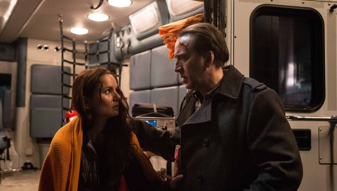 "Sarah Wayne Callies and Nicolas Cage in ""Pay the Ghost."""