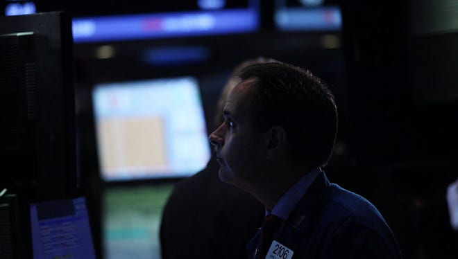 Traders work on the floor of the New York Stock Exchange (NYSE) on September 18, 2015 in New York City.