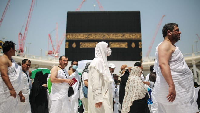 """Muslim pilgrims circle the Kaaba, the cubic building at the Grand Mosque in the Muslim holy city of Mecca, Saudi Arabia, Tuesday, Sept. 22, 2015. In Mecca, the holy site all the world's Muslims pray toward, the annual hajj pilgrimage began Tuesday with over 2 million faithful gathering to call out in Arabic: """"Here I am, God, answering your call. Here I am."""""""
