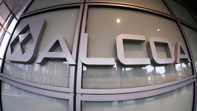 This April 7, 2014 photo shows the Alcoa logo in the lobby of the company's headquarters in Pittsburgh.