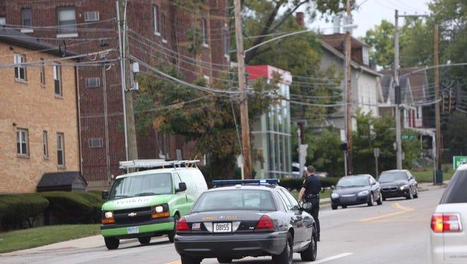 Cincinnati and Norwood police cars on Edroy Street.