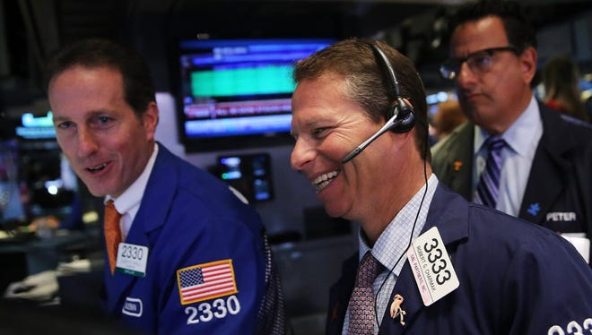 Traders work on the floor of the New York Stock Exchange (NYSE) on August 25, 2015 in New York City.