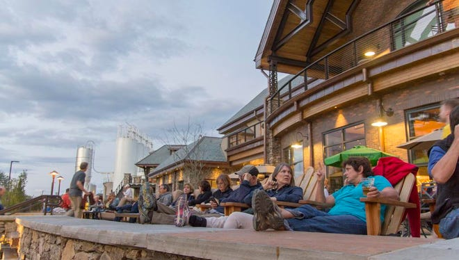 """When the Taproom at Sierra Nevada reopens May 12, 2021, the outdoor area will be open, but like the rest of the facility, it will be """"reservation only."""" This file photo was taken before the pandemic when a large crowd gathered for a Drive-By Truckers show."""