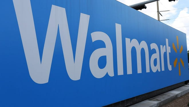 A Walmart sign is seen on August 18, 2015 in Miami, Florida.