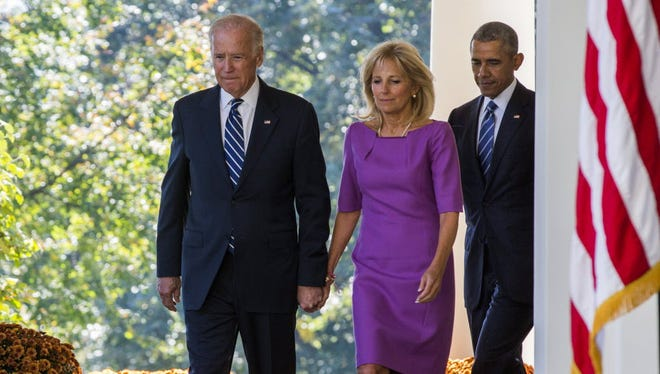 Vice President Biden, his wife, Jill Biden, and President Obama at the White House on Oct. 21, 2015.