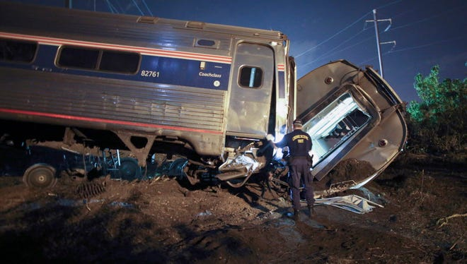 Emergency personnel work the scene of a deadly Amtrak train wreck in Philadelphia on May 12, 2015.