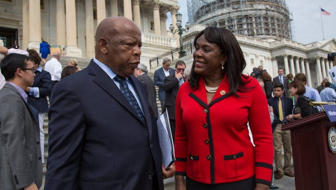 Rep. Terri Sewell, D-Ala., right, talks with Rep. John Lewis, D-Ga., after a press event to commemorate the 50th anniversary of the Voting Rights Act on the steps of the Capitol in Washington, D.C., on July 30, 2015.