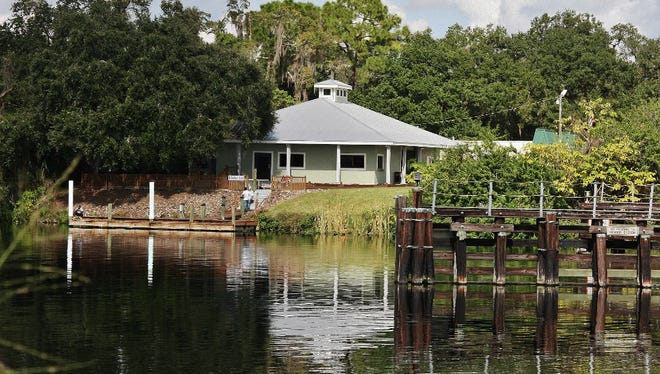 """A building and dock fronting the Caloosahatchee River on the west side of the Broadway drawbridge """"awaits to be the future hot spot for downtown Alva,"""" according to a real estate agent."""