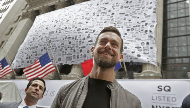 Square CEO Jack Dorsey, foreground, visits outside the New York Stock Exchange before opening bell ceremonies, Thursday, Nov. 19, 2015