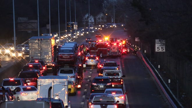 Emergency workers at the scene of a car accident on the northbound side of I-95 in Rye, November 29, 2015.