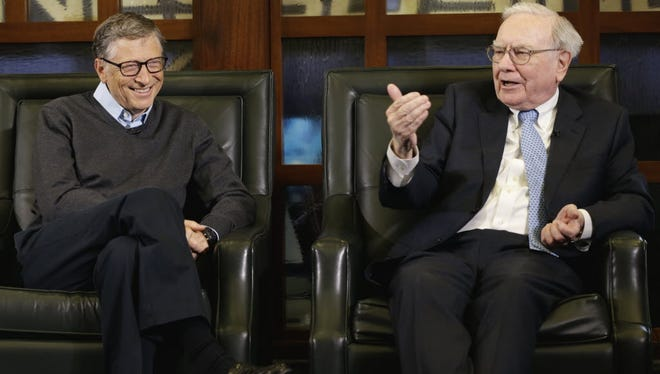 Bill Gates, left, along with his wife Melinda, and Warren Buffett, shown here in 2014, started the Giving Pledge in 2010 in an effort to get the world's billionaires to give away at least half of their money during their lifetimes.