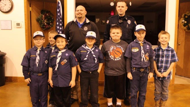 The Bear Den of Pack 165 would like to thank Officer Perry Deese and Officer Justin Martin for visiting the den. They talked to the boys about what they do from day to day in their jobs, how they protect citizens, and the gear they use. Back: Officer Perry Deese & Officer Justin Martin. Front, from left: Konnor Wincliff, Cameron Killian, Justin Suntken, James Carter, Weston Brown, Charlie Bailey, and Gauge Wells.