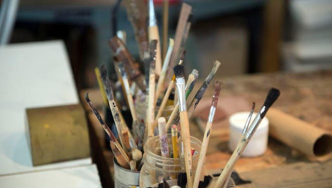 A collection of used paint brushes sit in the studios of Asheville artist Daniel Essig. Essig's studios are located in the Grovewood Gallery located at 11 Grovewood Road near the Grove Park Inn.