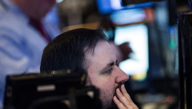 A trader works on the floor of the New York Stock Exchange during the afternoon of December 4, 2015 in New York City.