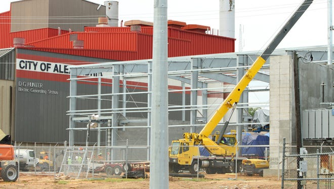 Work is proceeding on a project to install new generators at the city of Alexandria's power plant. City officials have agreed to lower electricity rates as part of a plan that will include raising gas, water and wastewater rates.