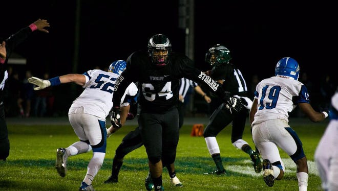 Winslow Twp. offensive lineman Devon Robinson looks to make a block against Paul VI.