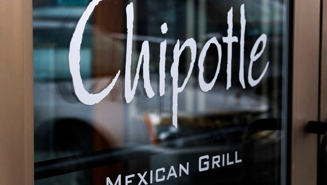 This Jan. 28, 2014, file photo, shows the door at a Chipotle Mexican Grill in Robinson Township, Pa.