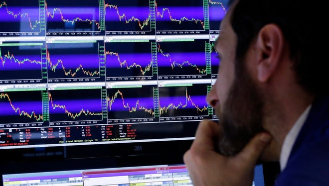 Specialist Michael Pistillo watches his screens at his post on the floor of the New York Stock Exchange, Friday, March 6, 2015.