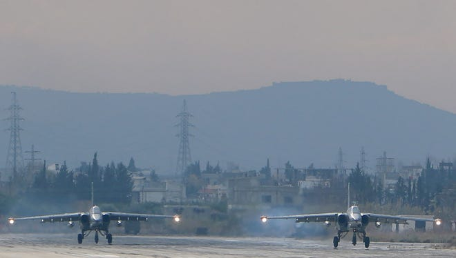 Two Russian Sukhoi Su-24 bombers at the Russian Hmeimim military base in Latakia province, northwest of Syria, on Dec. 16, 2015.
