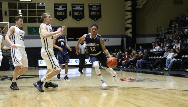 Justin Robinson drives to the basket during Monmouth University's 91-84 loss at Army on Monday evening