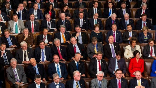 GOP lawmakers watch President Obama on Jan. 12, 2016.