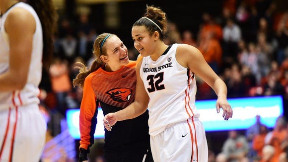 Oregon State's Deven Hunter (right) with teammate Sydney Wiese during last Sunday's victory against Stanford.