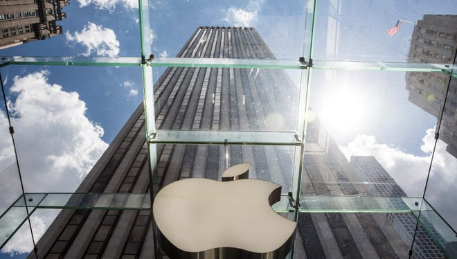The Apple logo hangs on the Apple Store on Fifth Avenue on August 5, 2015 in New York City.