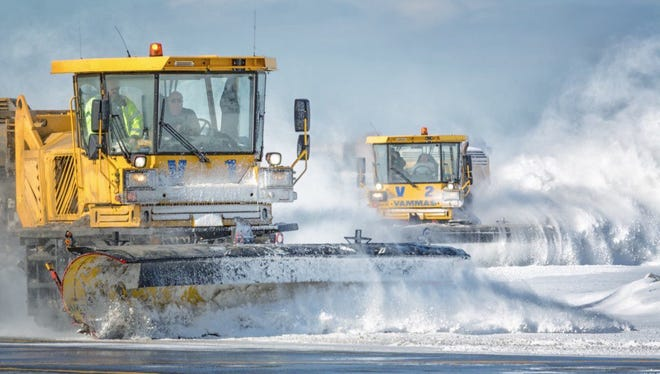 Plows clear snow from one of the airports run by the Port Authority of New York and New Jersey.