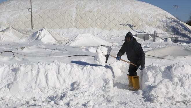 Snow removal began Sunday morning after the roof of Sports Underdome in Mount Vernon collapsed Saturday.