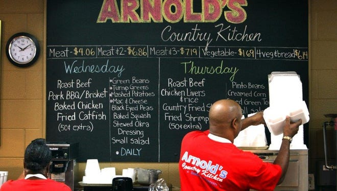 The menu at Arnold's Country Kitchen meat-and-three, where patrons raced to pay for soldiers' meals Jan. 27, 2016.
