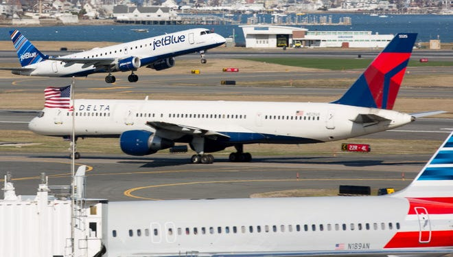 JetBlue, Delta and American airlines planes are seen at Boston''s Logan International Airport on April 13, 2015.