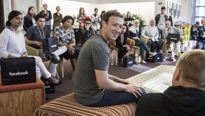 Facebook CEO Mark Zuckerberg met with 18 Facebook users the company brought to Menlo Park, Calif., to help mark the social network's 12th birthday.