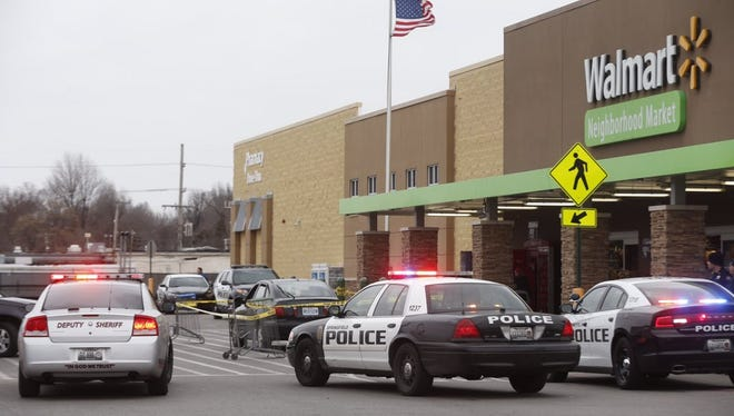 Police cordon off a car parked in a Springfield Walmart parking lot