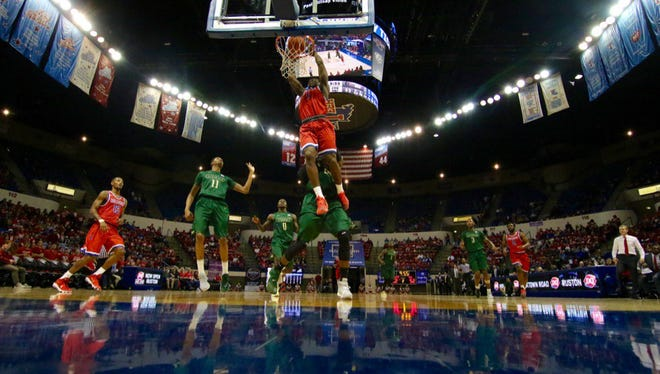 Louisiana Tech guard Derric Jean goes up for a dunk in Saturday's win over UAB.
