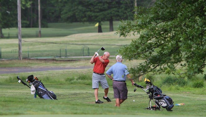 Golfers tee off at the Sun Eagles Golf Course in this May 2015 file photo.